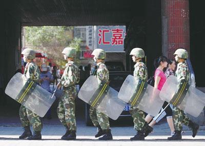 中共在新疆防衛過當,該當何罪