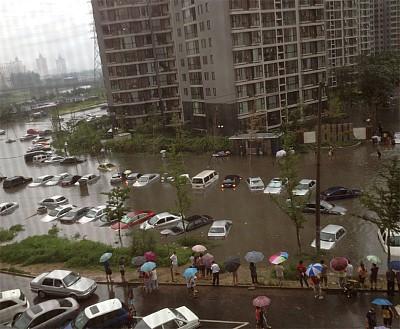 北京暴雨演繹「擊鼓傳花」 九常委集體沉默內情